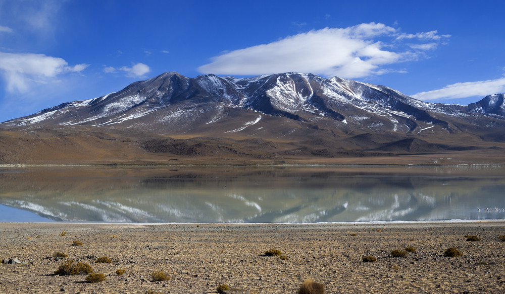 Snow-capped mountains reflected in a tranquil lake