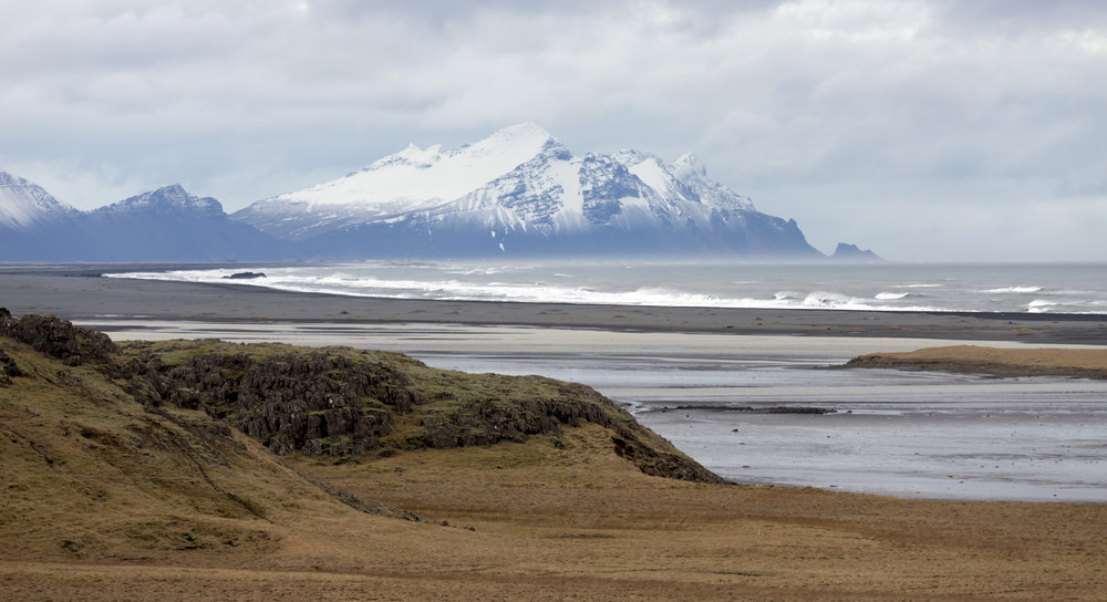 Ocean and a snow-capped mountain