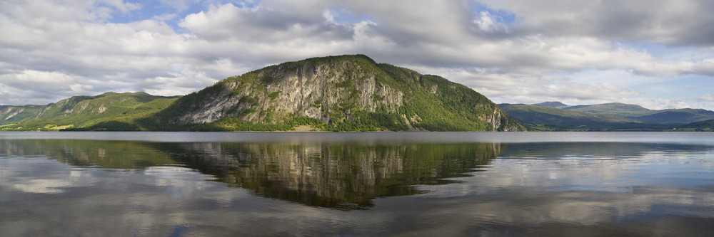 Forested mountain reflected in a calm lake