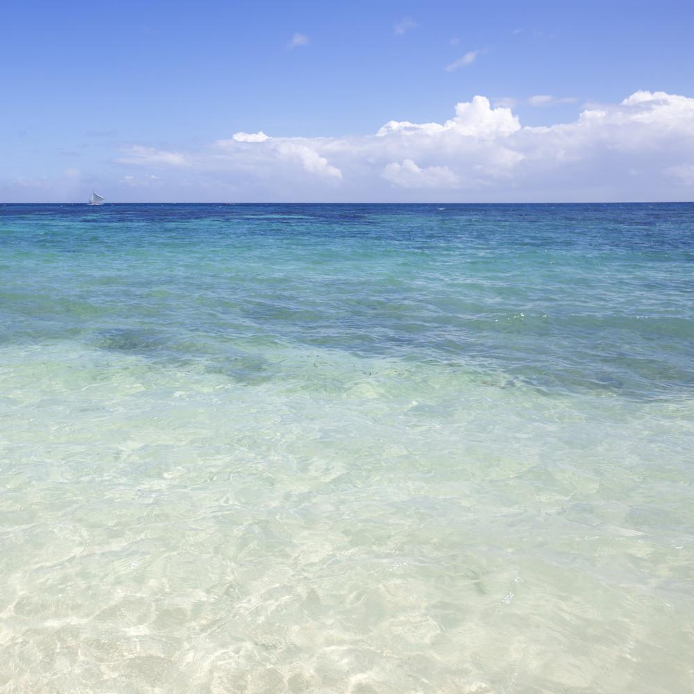 Clear, tropical ocean under a blue sky