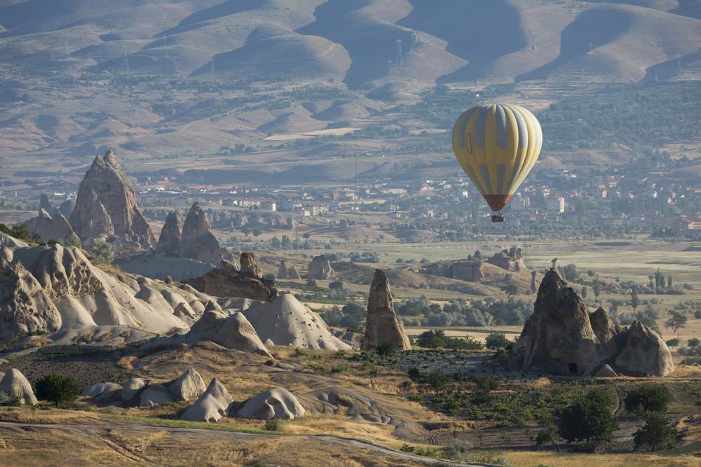 Hot air balloon over a rocky landscape