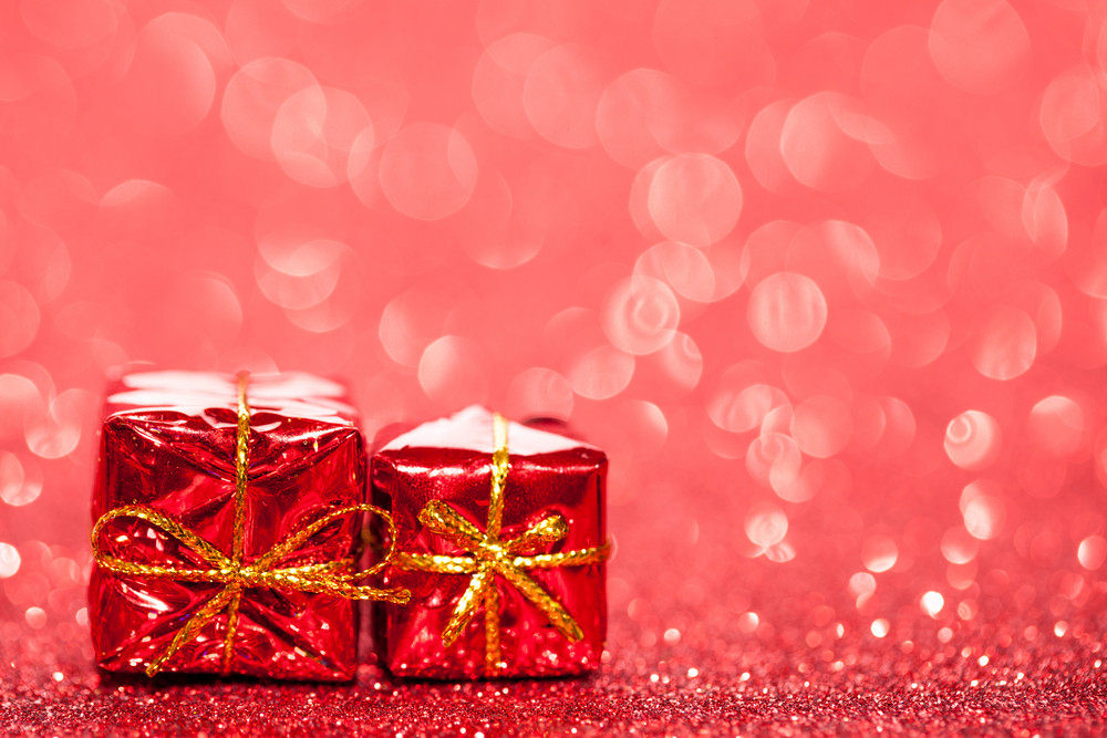 Decorated red holiday gifts