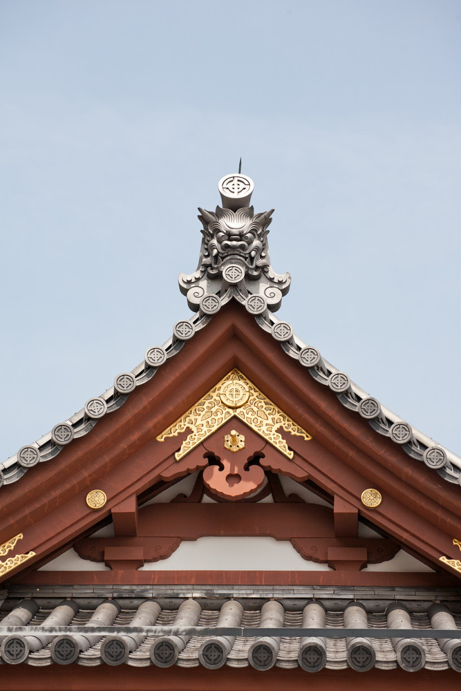 Detail on japanese temple roof against blue sky