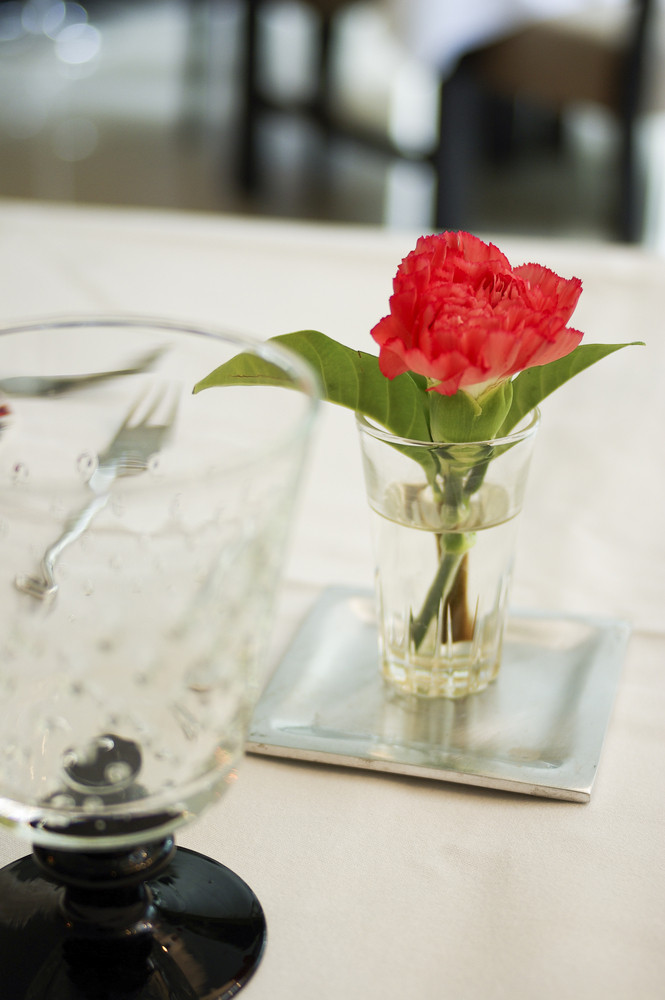 Dinning table set with red flower