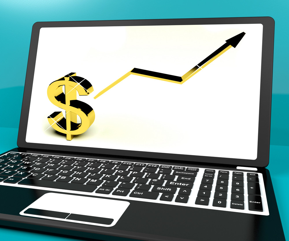 Dollar Sign And Up Arrow On Computer For Earnings Or Profit