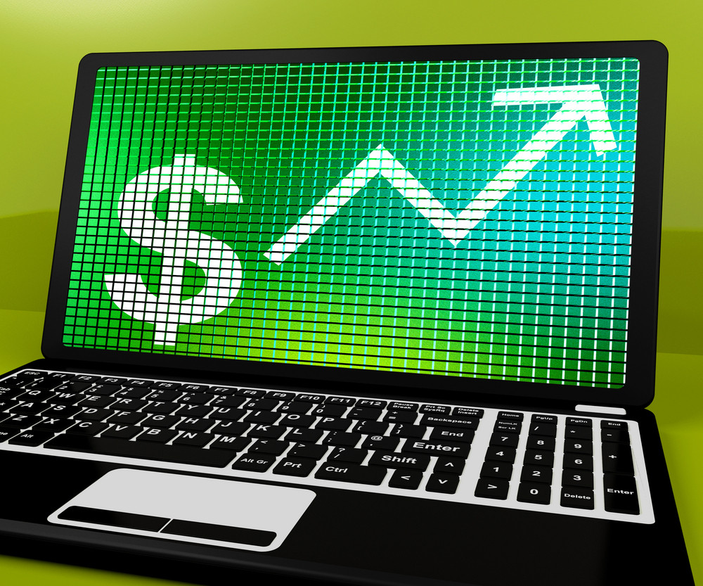 Dollar Sign And Up Arrow On Laptop For Earnings Or Profit