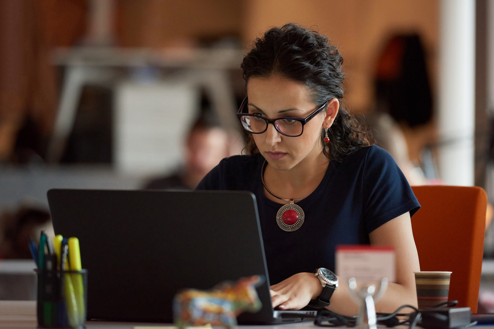 Woman  Working On Laptop Computer At Modern Office