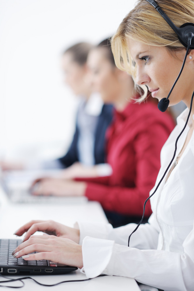 Business woman group with headsets