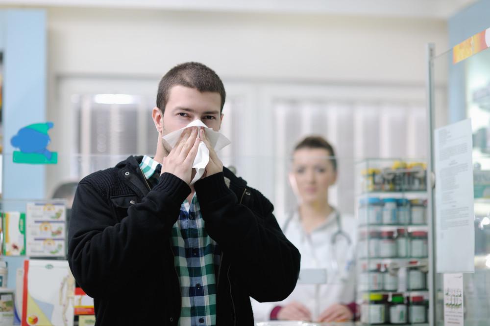 Sick man in pharmacy