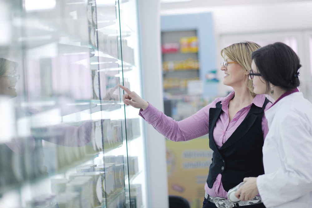 Pharmacist suggesting medical drug