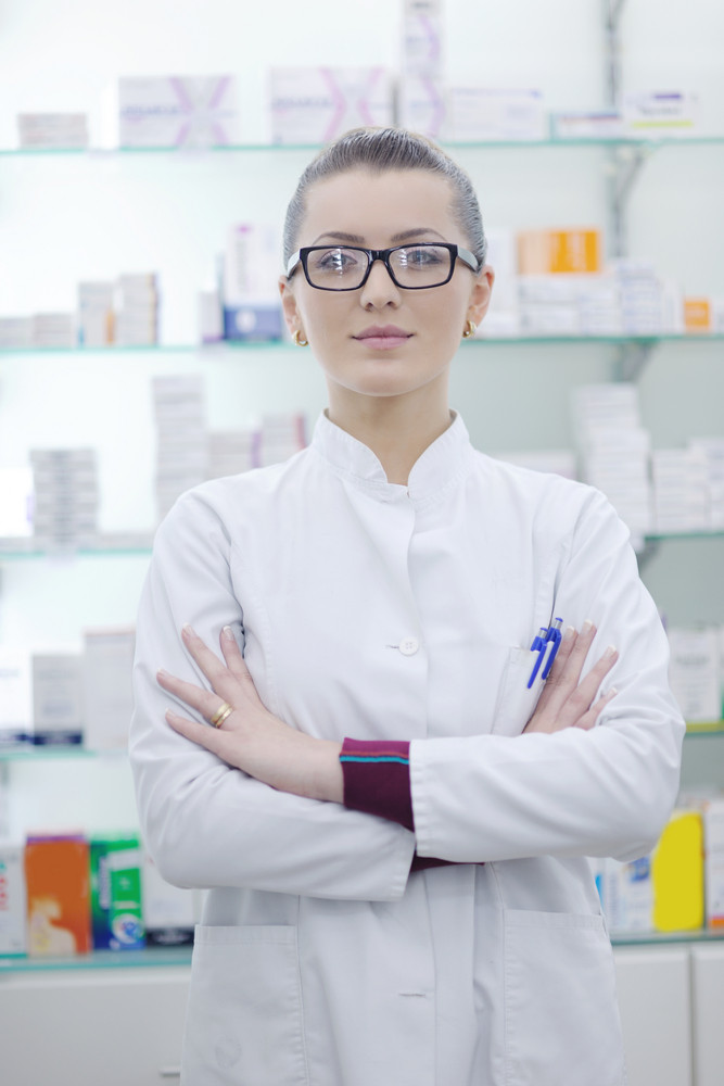 Pharmacist chemist woman standing in pharmacy drugstore