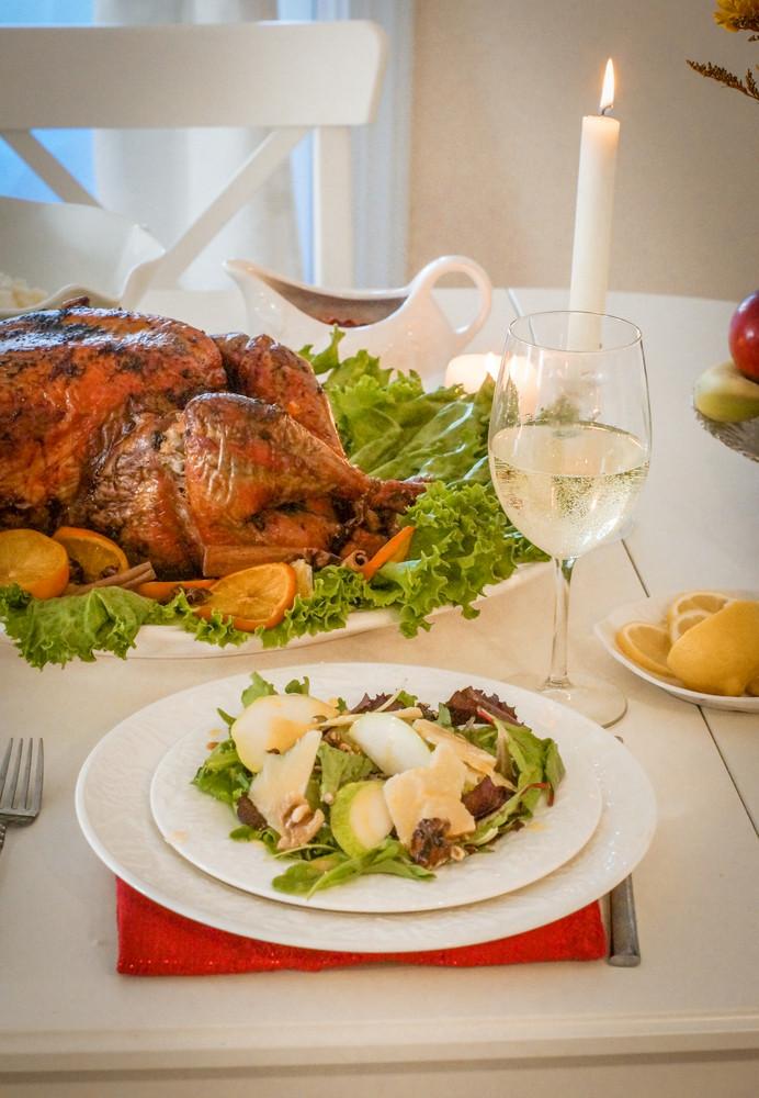 Garnished Citrus Glazed Roasted Turkey And Pea Salad On Holiday Table