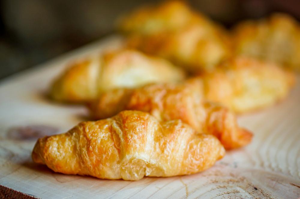 Fresh Croissant On Wooden Background