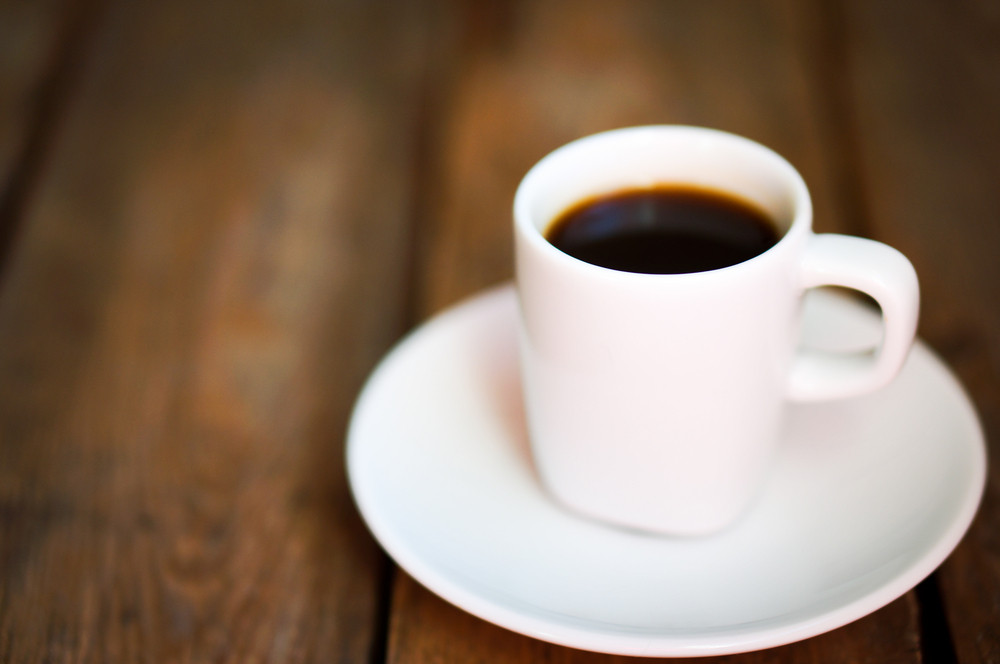 Cup Of Fresh Coffee On Rustic Wooden Background