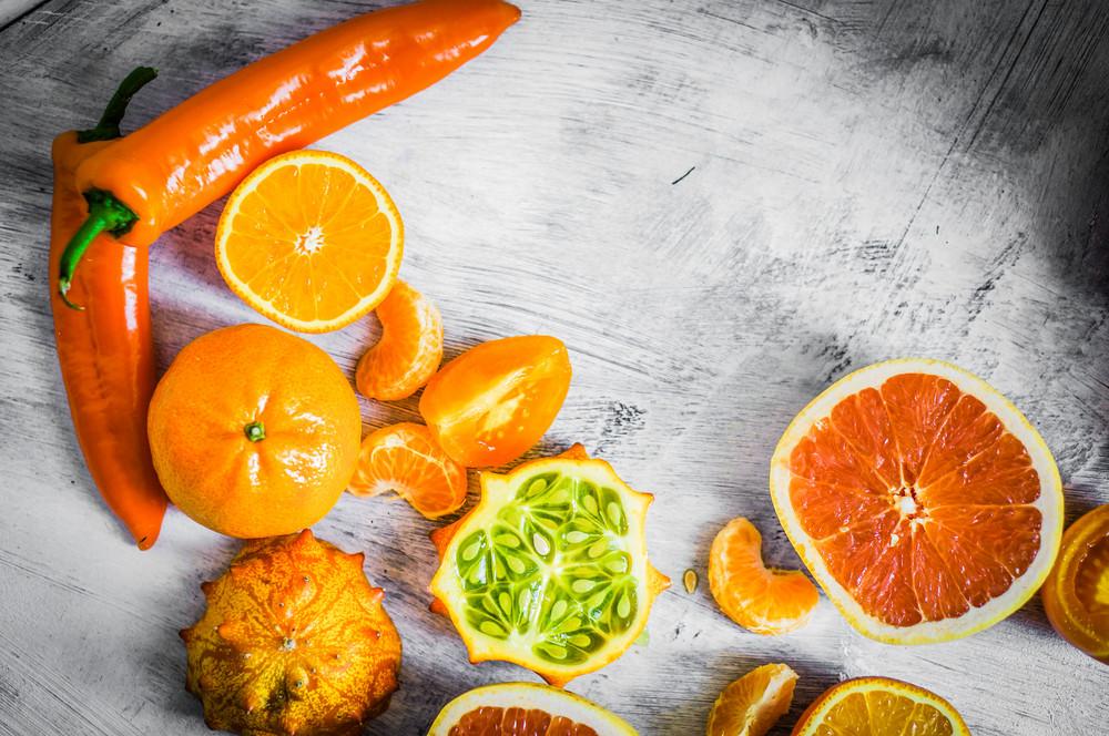 Orange Fruits And Vegetables On Rustic Background