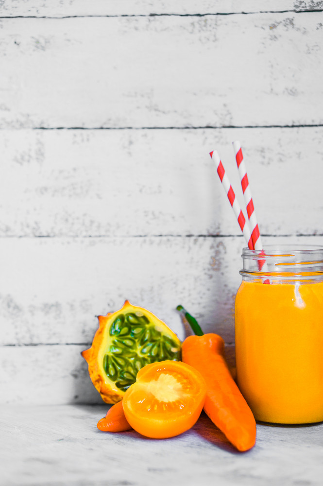 Orange Smoothie On Rustic Background