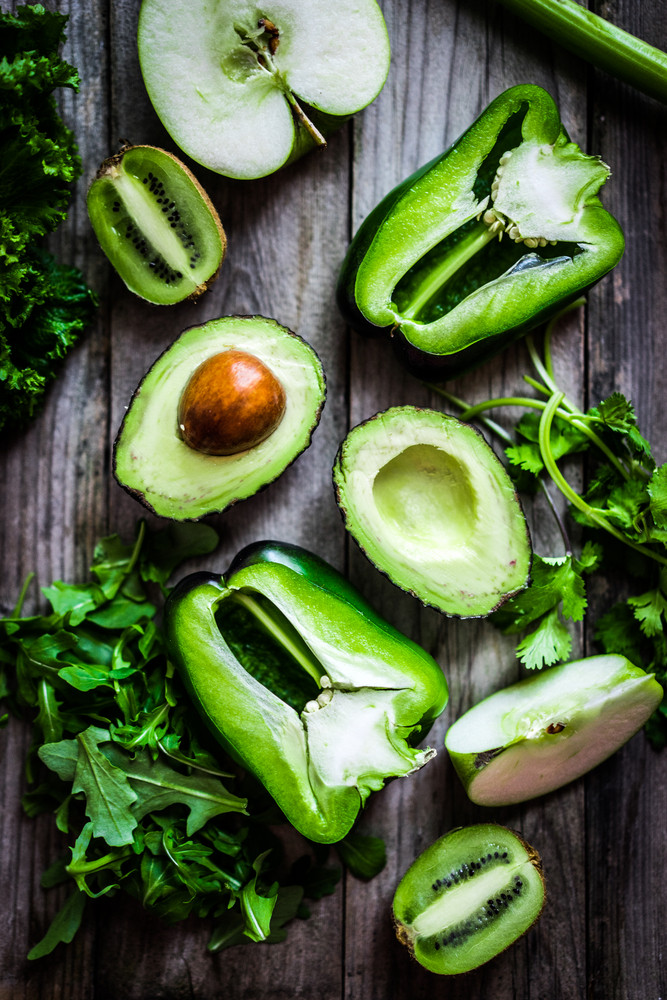 Mix Of Green Vegetables And Fruits On Rustic Background