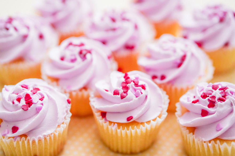 Cupcakes With Pink Cream And Heart Sprinkles