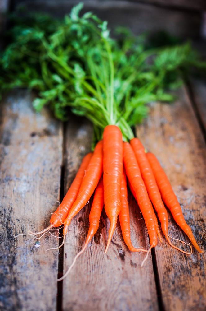 Farm Raised Organic Carrots On Wooden Background