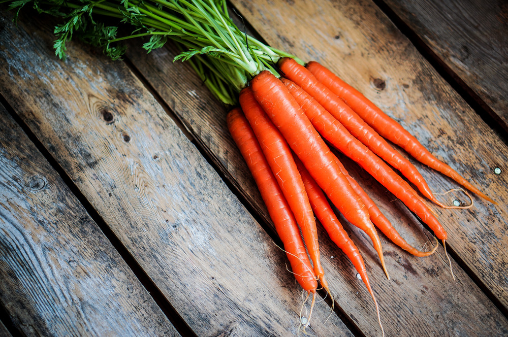 Farm Raised Organic Carrots On Wooden Background