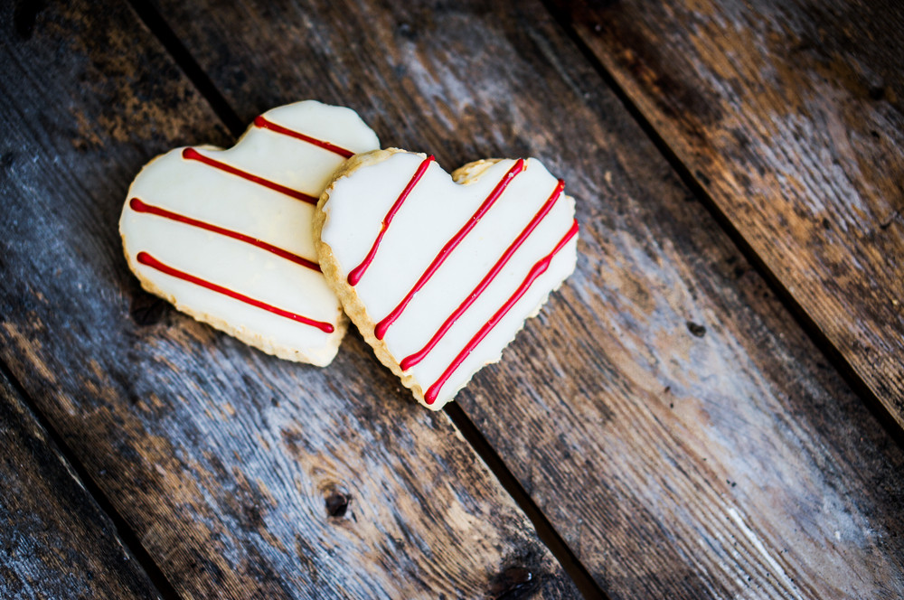 White And Red Heart Cookies On Rustic Wooden Background