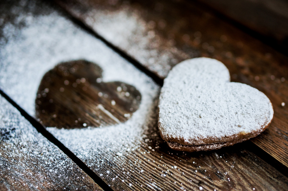 Heart Cookies With Sugar Powder On Rustic Wooden Background