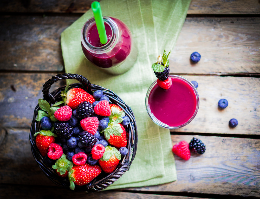 Berry Smoothie On Rustic Wooden Background