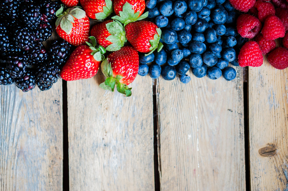 Mix Of Berries On Rustic Wooden Background