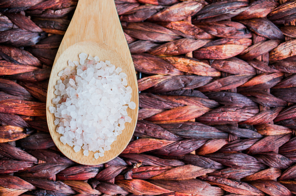 Closeup Of Pink Hymalayan Salt On Rustic Wooden Background