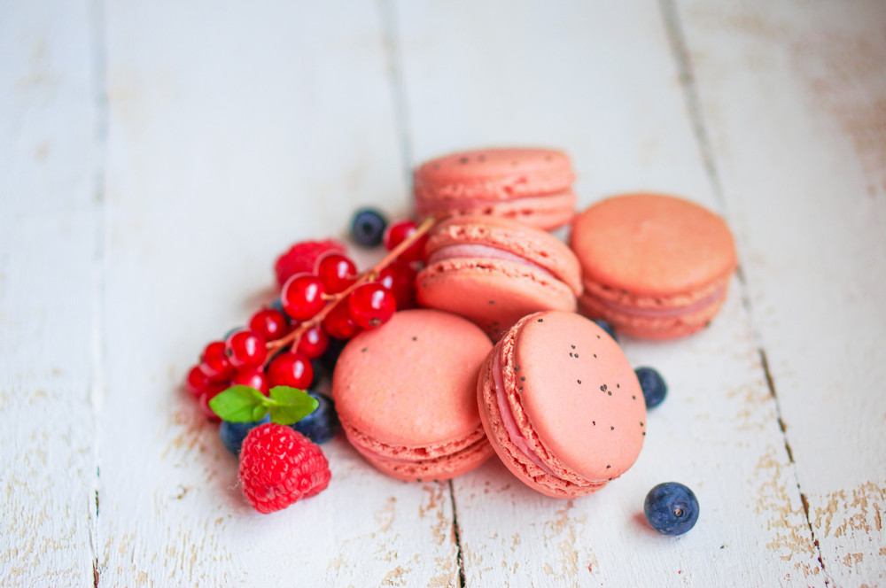 Raspberry Macaroons With Berries On Wooden Table