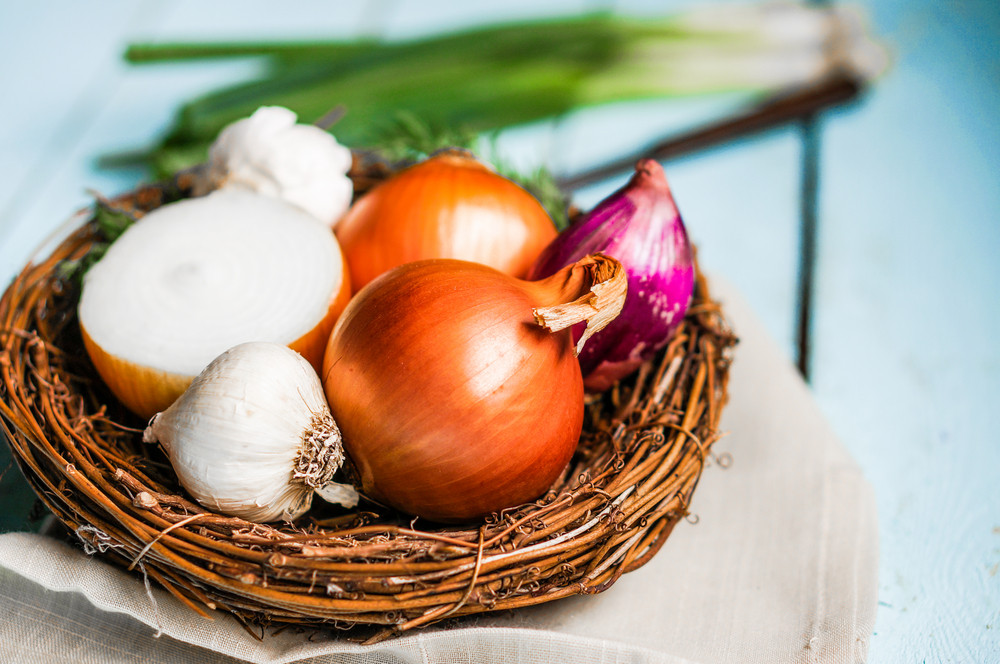 Colorful Onions And Garlic On Rustic Wooden Background