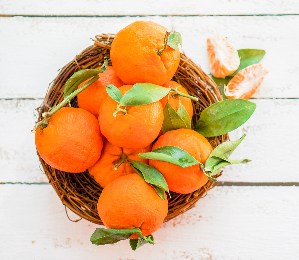 Tangerines In The Basket On Wooden Background