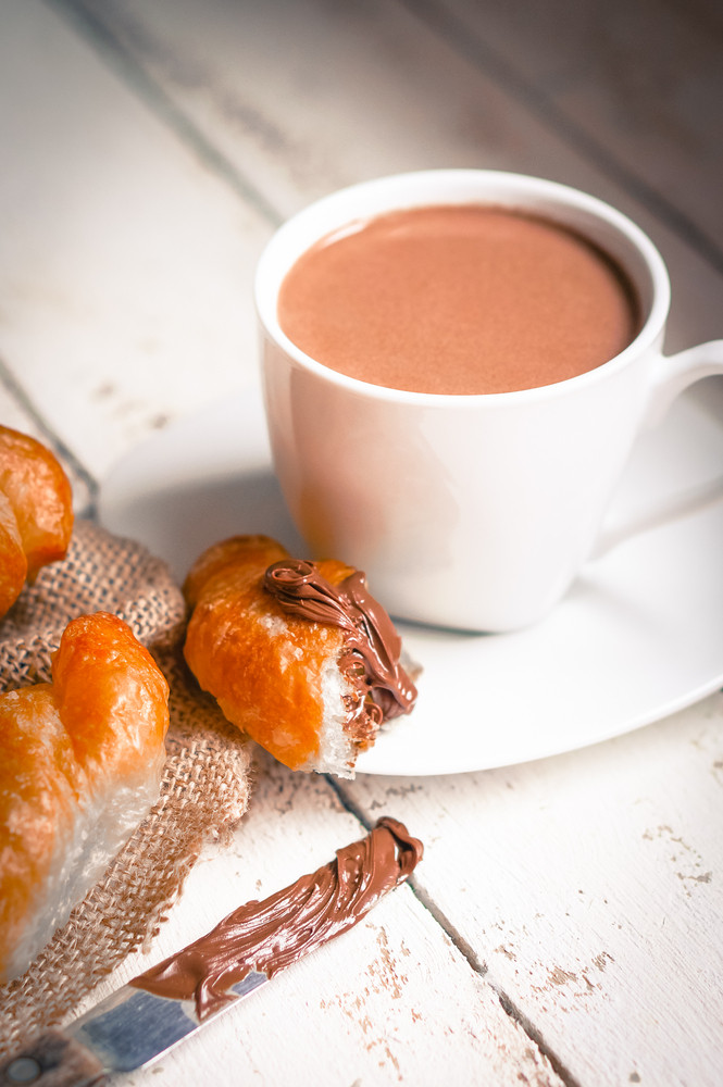 Fresh Baked Croissants With Chocolate Cream And Hot Cocoa On Wooden Background