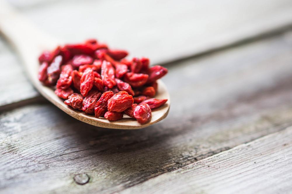 Goji Berries On Wooden Background