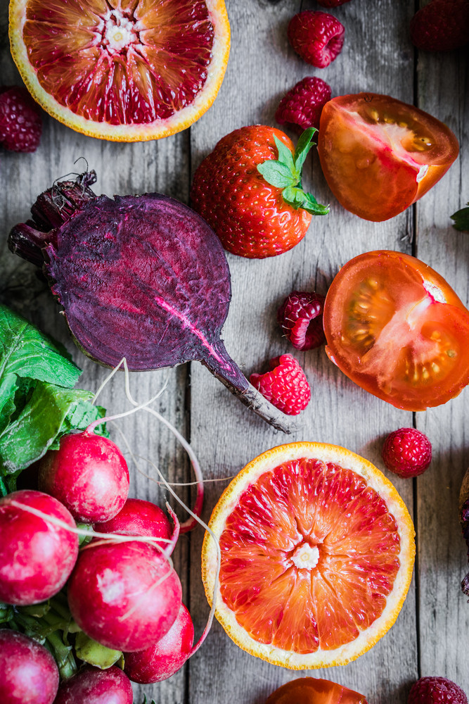 Red Fruits And Vegetables On Wooden Background