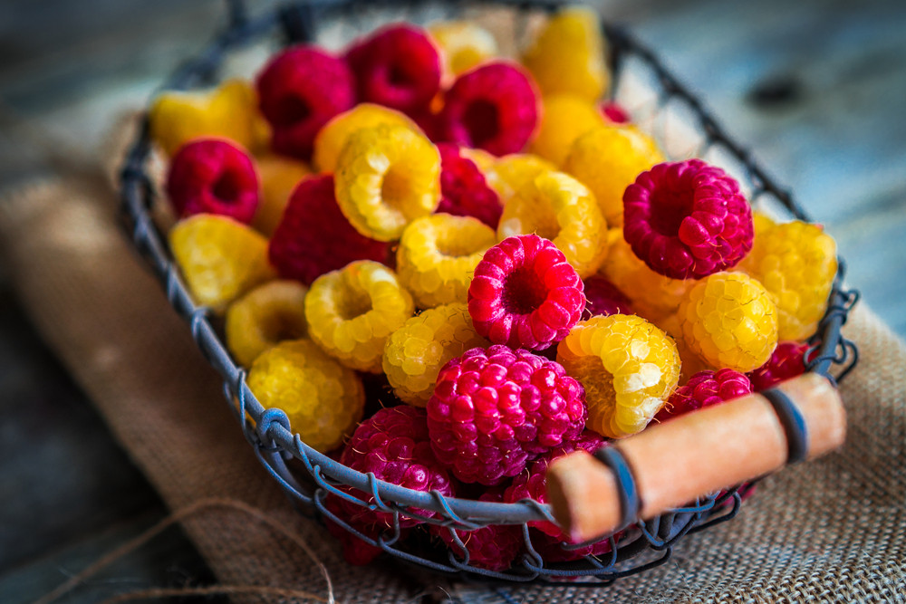 Colorful Raspberries On Wooden Background
