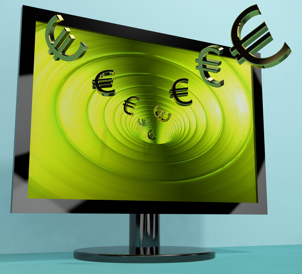 Euro Symbols From Computer Screen Showing Money Investments And Winning