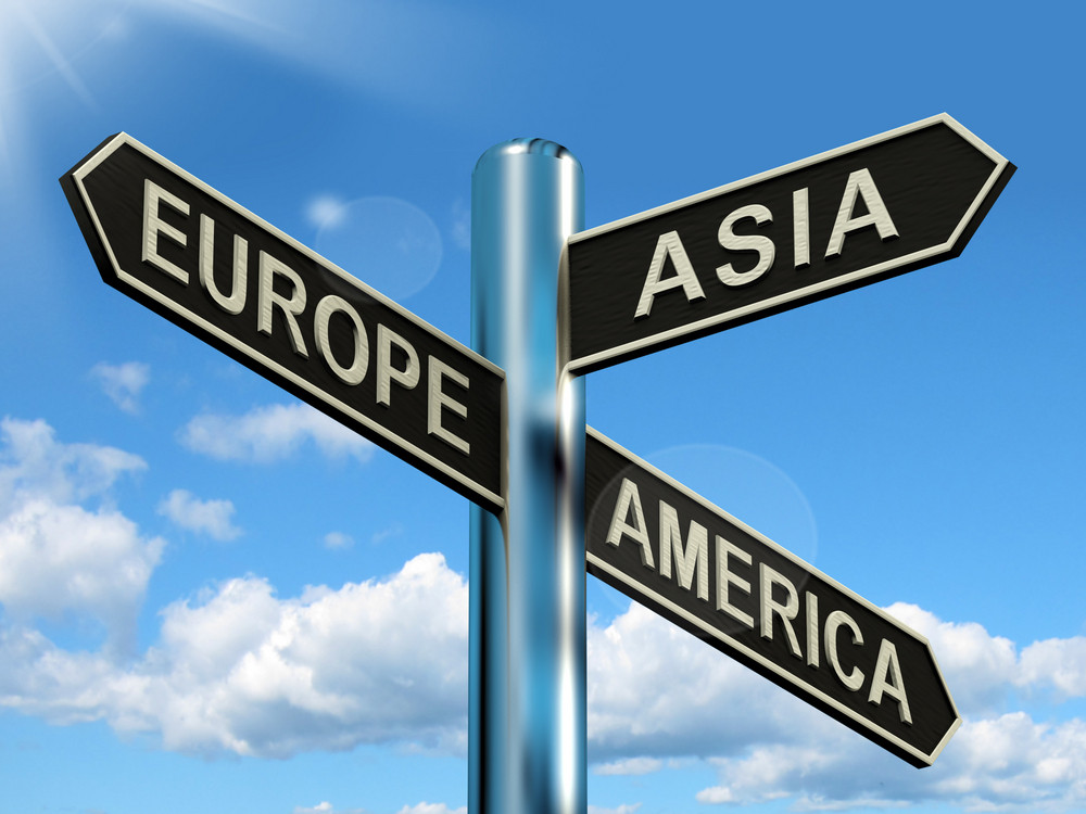 Europe Asia America Signpost Showing Continents For Travel Or Tourism