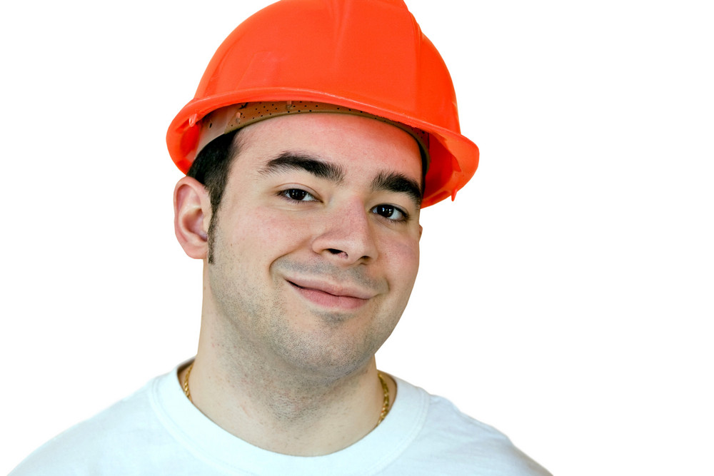 Everyday construction worker smiling isolated over a white background.