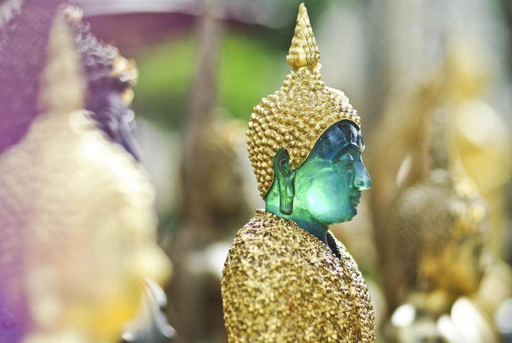 face of thai Buddha Green Statue closeup