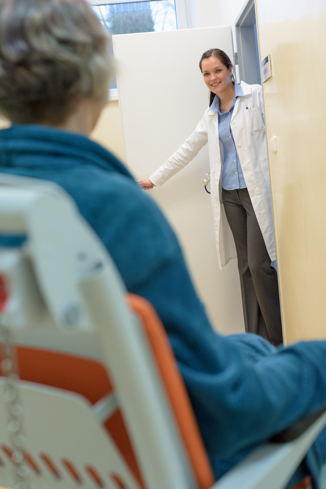 Female doctor calling a senior patient in hospital for checkup