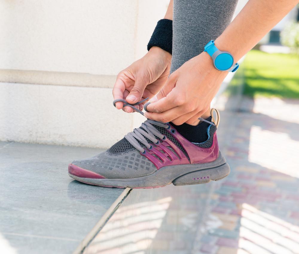 Female hands tying shoelaces