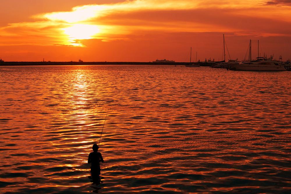 Fisherman-and-sunset