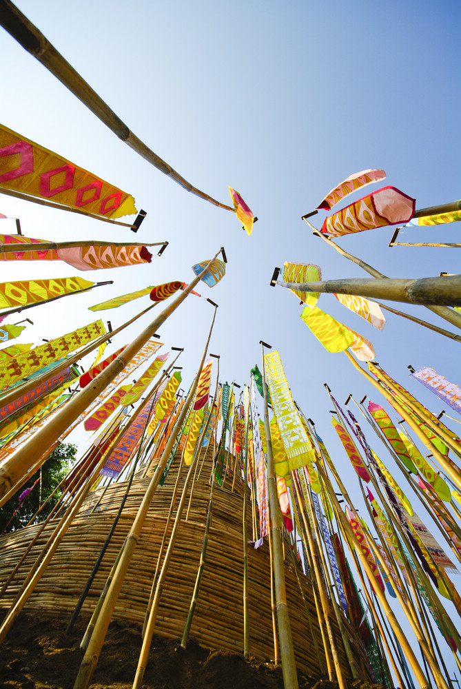 Flag hang Songkran Festival. One of the traditions of northern Thailand. The Hang Tung and colorful embroidery. The pagoda is made of sand
