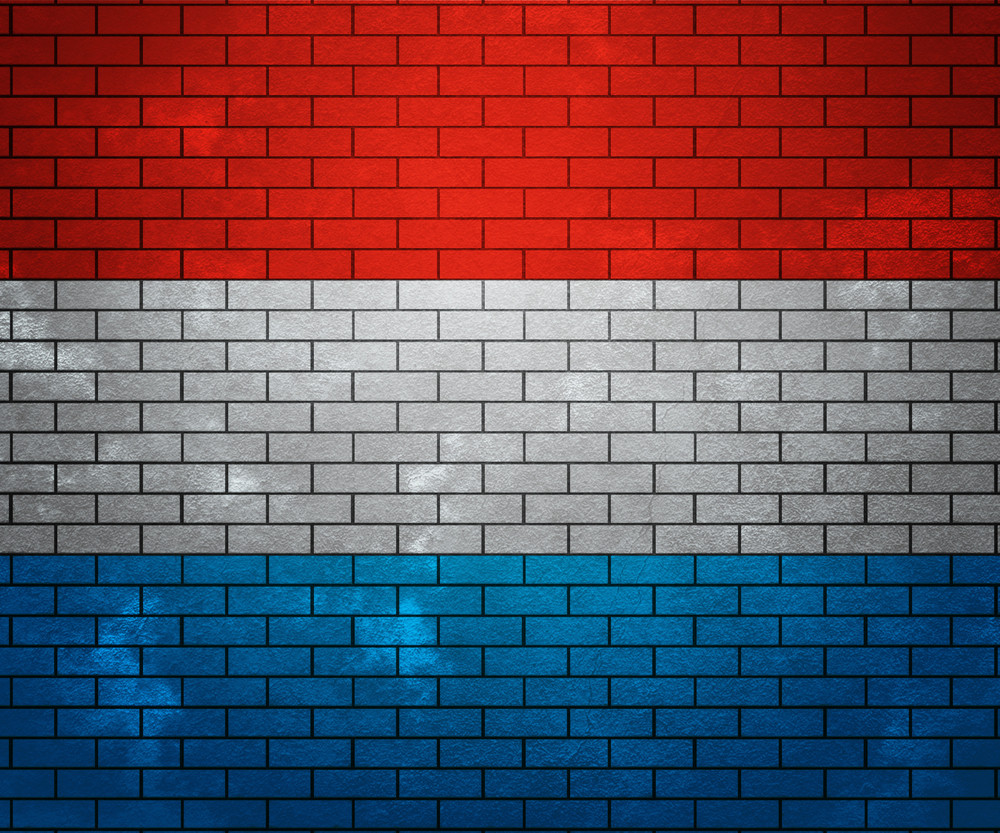 Flag Of Luxembourg On Brick Wall