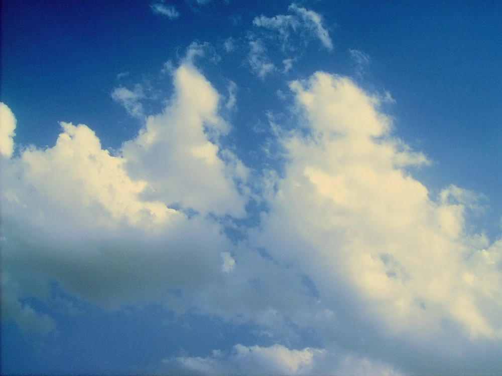 Floating Clouds In Sky