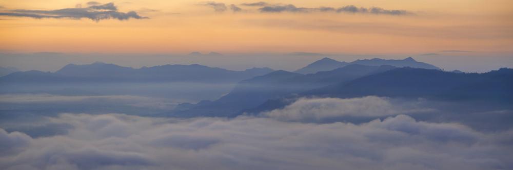 Foggy mountain range at sunset