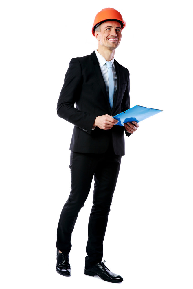 Full length portrait of a happy businessman in helmet holding blue folder over white background