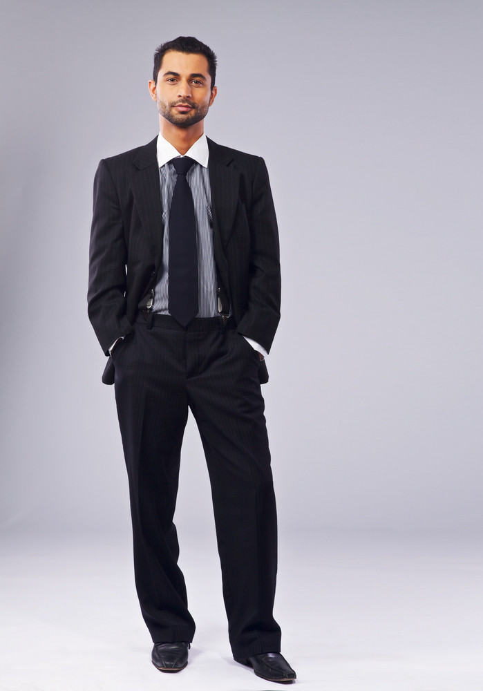 Full length portrait of a young executive standing in a studio
