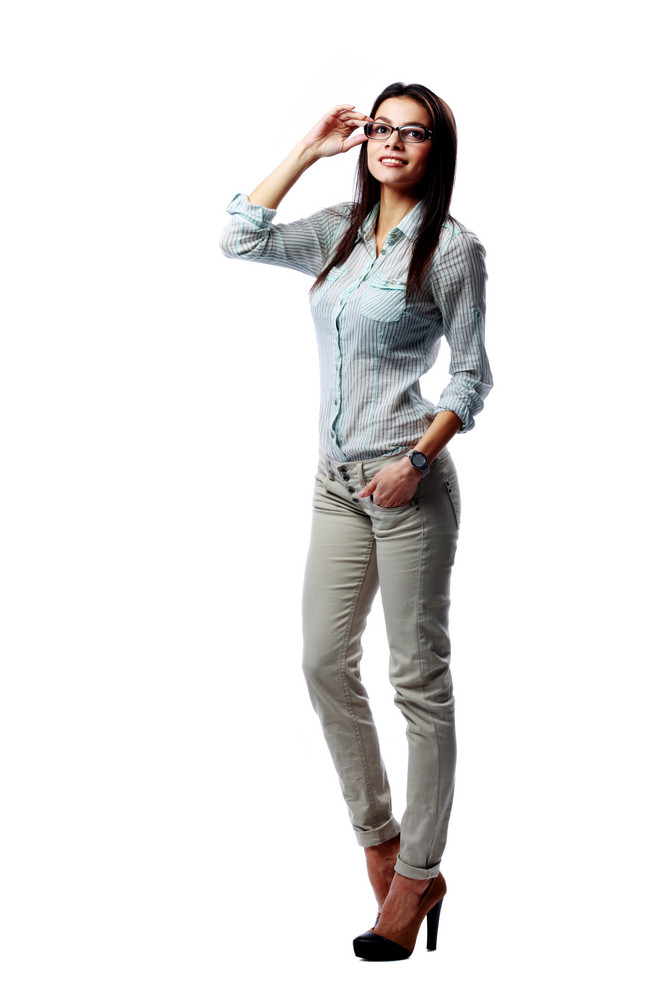 Full-length portrait of a young happy businesswoman standing isolated on a white background